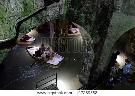 RAMLA ISRAEL - JULY 22 2017: Boating in the underground Arched Pool - an ancient reservoir for drinking water