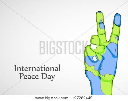 illustration of hand and fingers in earth background with International Peace Day text on the occasion of International Peace Day