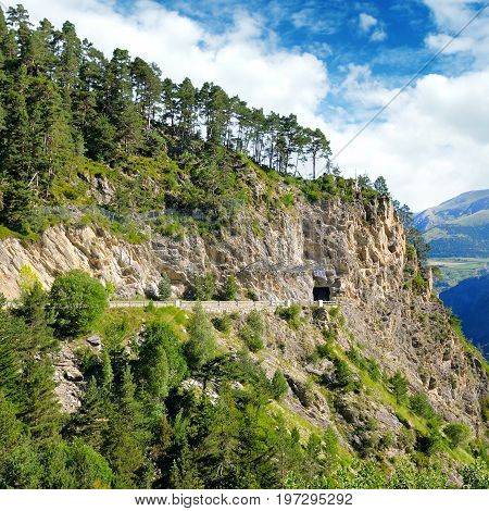Mountains of the Pyrenees high-altitude road and tunnel.