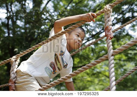 Japanese Boy Playing With Ropewalking (second Grade At Elementary School)