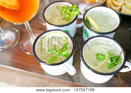 Moscow mule cocktail with lime, mint and cucumber. outdoor