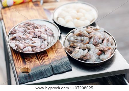 Fresh raw seafood. On metal table. outdor