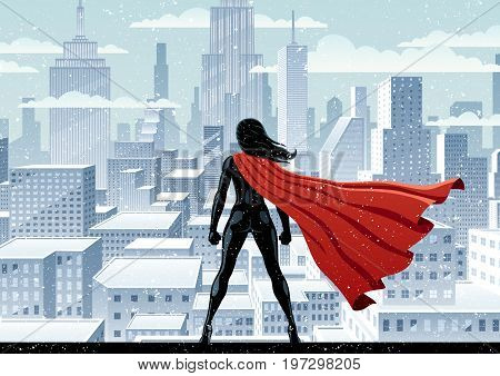 Super heroine watching over city on snowy day.