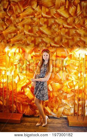 Fashionably-dressed Bridesmaid Posing Against Decorative Golden Wall In The Restaurant At Bacheloret