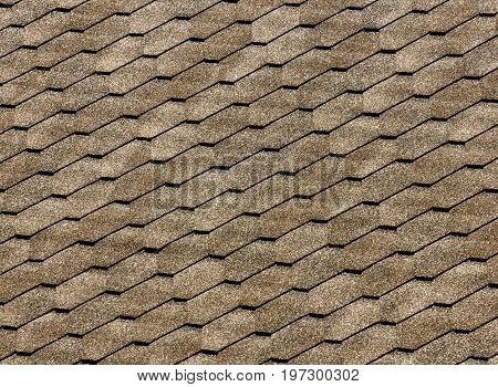 Asphalt roof shingles - roofing construction, roofing repair. for background or texture.