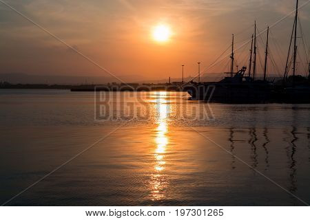 Beautiful Port For Luxury Yachts In The Rays Of The Setting Summer Sun. Sunset At The Port For Yacht