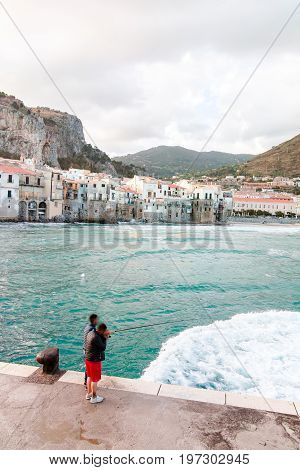 Touristic And Vacation Pearl Of Sicily, Fishermen In Small Town Of Cefalu, Sicily, South Italy, Sea