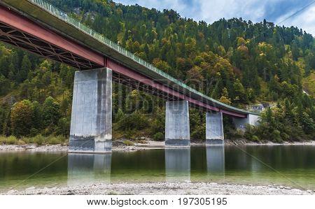 The bridge at Sylvenstein lake on a gloomy autumn day. Germany