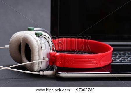 Headphones And Black Laptop. Music And Digital Equipment Concept