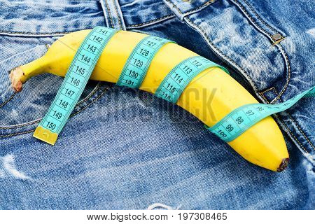 Banana Wrapped With Blue Measure Tape As Male Genitals Imitation