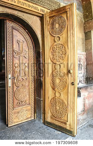 Entrance wooden doors with cross at Church of the Martyr Gayane in Echmiadzin