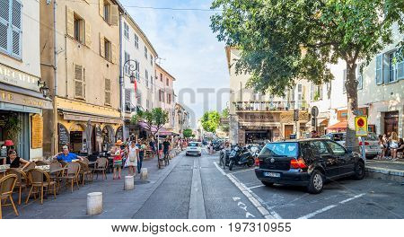 Antibes, France - July 01, 2016: day view of typical street in Antibes France. Antibes is a popular seaside town in the heart of the Cote d'Azur.