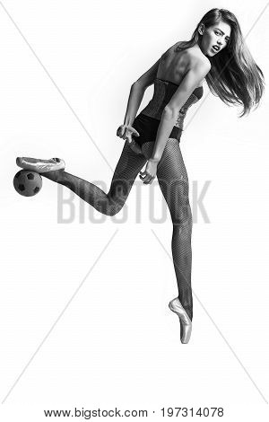 girl football player or woman ballerina with long hair and legs in pointe shoes and body suit with ball black and white