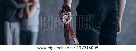 Man Squeezing Belt