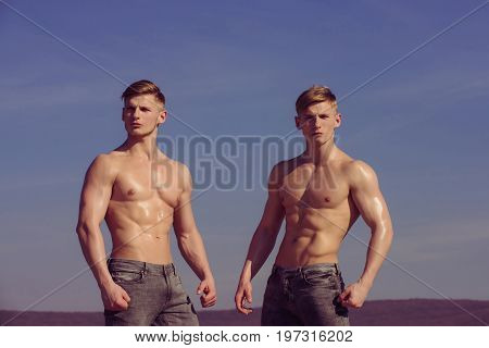 Sport and workout. Athletic bodybuilders pose as hercules. Gladiator or atlant. Men with muscular wet body. Guys with glitter on bare chest.