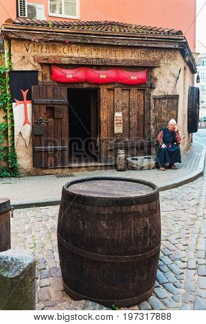 Man In Traditional Clothes At  Entrance Into Restaurant Riga Baltic