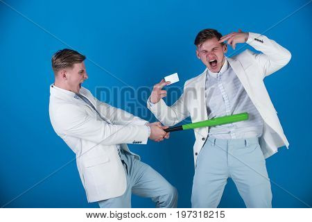 Businessman Batting Rival With Baseball Bat