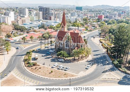 WINDHOEK NAMIBIA - JUNE 17 2017: An aerial view of Windhoek central business district with the Christuskirche an historic German Lutheran church in the front