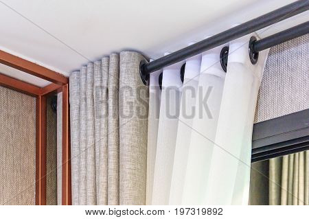 The white curtains with ring-top rail in new apartment
