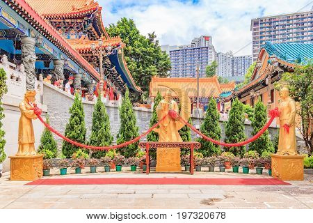 HONG KONG, CHINA - JULY 21, 2013: Statue of Yue Lao or old man under the moon chinese god of marriage at Sik Sik Yuen Wong Tai Sin Taoist Temple in Kowloon Hong Kong.