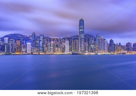 Hong Kong city skyline at sunset and twilight panorama view Kowloon public pier the cityscape of business and financial district one of the world's most significant financial centres Asia-Pacific