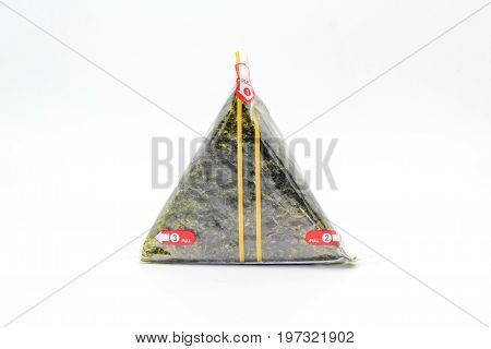 Portable Onigiri a Japanese rice ball wrapped with seaweed in sealed plastic on white background with Copy space and text.