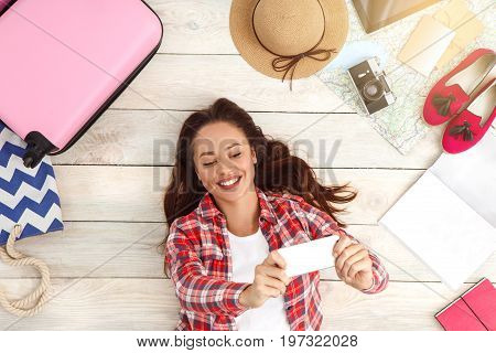 Young female traveler tourist top view packing taking photos
