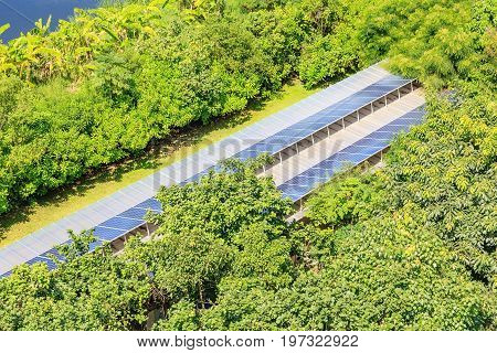 Photovoltaic solar panels on building roof for renewable energy or electricity generation