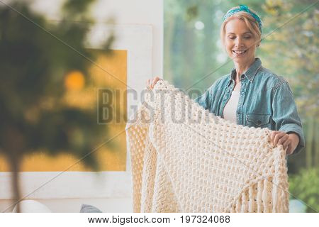 Woman Is Arranging White Coverlet