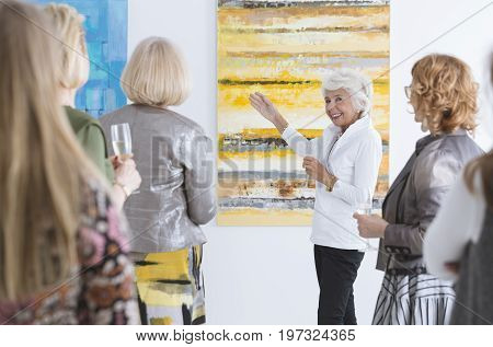 Lady Talking About Painting