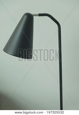 Table lamp made of black plastic in bedroom