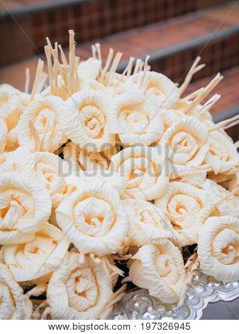 Dok Mai Chan. Thai artificial flowers used during a funeral. kind of wood flower to be placed on the site of cremation.