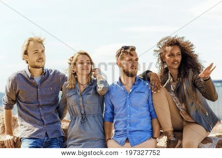 Young Middle Eastern Girl Showing Direction To Her Multiracial Buddies