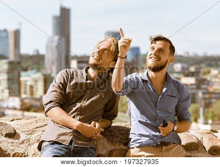 Young Man Shows Something Interesting To His Buddy