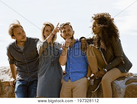 Young Girl Showing Direction To Her Multiracial Buddies