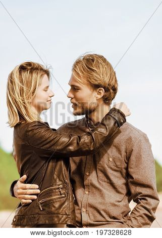 Young Caucasian Couple Looking At Each Other While Dating