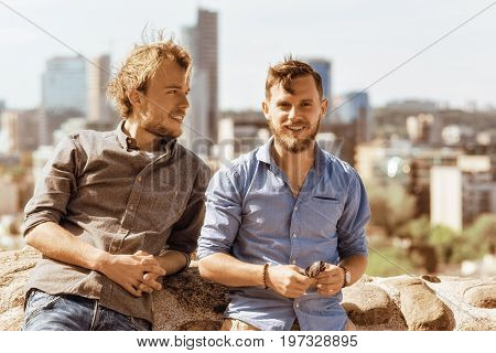 Young Caucasian Buddies In Front Of City Skyline