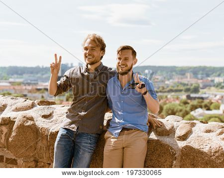 Smiling Young Caucasian Buddies In Front Of City Skyline