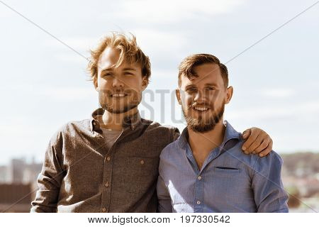 Handsome Young Caucasian Buddies At City Panorama