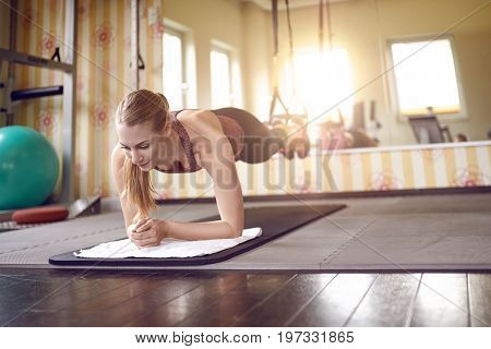 Young Fit Blond Woman Doing Front Planks
