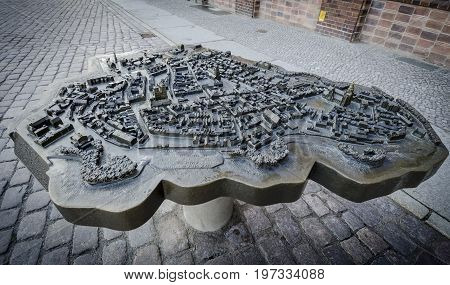 STRALSUND, GERMANY, 12TH SEPTEMBER 2012 - Bronze scale model of the town of Stralsund in Germany with braille description