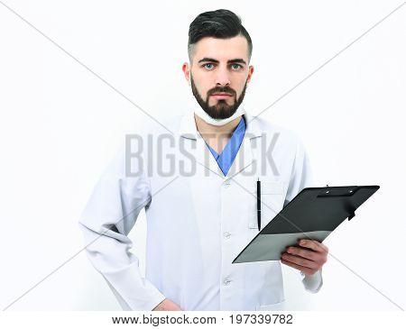 Doctor With Beard Holds Clip Folder For Prescription