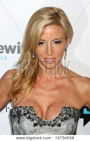 """LOS ANGELES - OCT 11:  Camille Grammer arrives at the """"Real Housewives of Beverly Hlls"""" Premiere Party at Trousdale.Theatre on October 11, 2010 in West Hollywood, CA"""