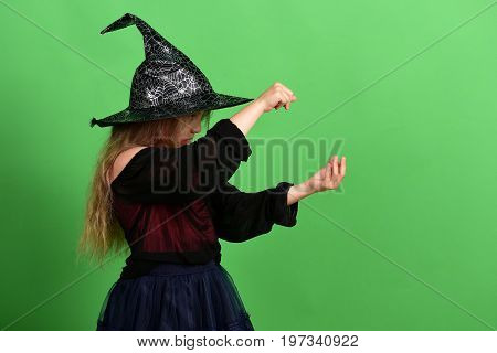 Kid In Black Witch Hat, Dress And Serious Face
