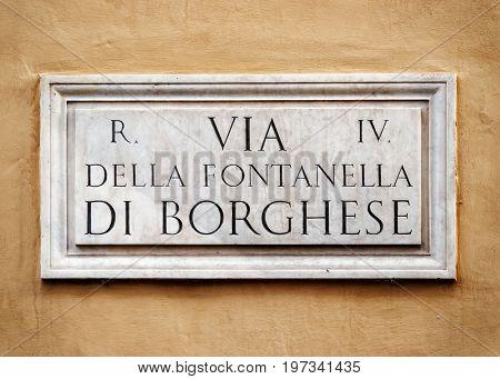 Via Della Fontanella Di Borghese Sign On Wall In Rome