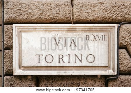 Via Torino Street Sign In Wall In Rome