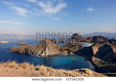Padar Island With Scenic High View Of Three Beautiful White Sandy Beaches Surrounded By A Wide Ocean