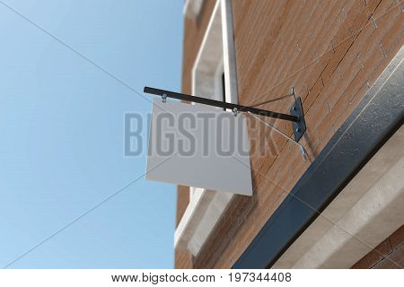Empty sqare stopper hanging on red brick building. Blue sky background. Advertising concept. 3D Rendering