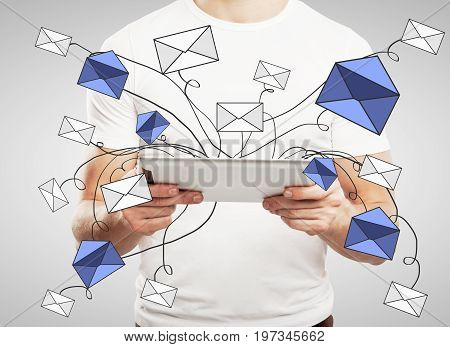 Man using tablet with abstract e-mail network on gray background. Message concept. 3D Rendering