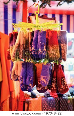 Counter With Wool Knitted Mittens At Christmas Market Night Riga